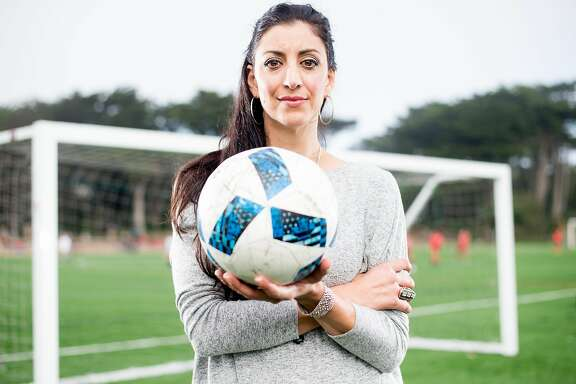 Alexandra Christ stands for a portrait at the Beach Chalet Soccer Fields on Sunday, Nov. 6, 2016. Christ started a crowd-funded program to provide free soccer balls to children in refugee camps in Greece.