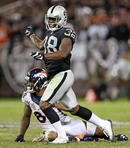 Oakland Raiders' T.J. Carrie celebrates breaking up a pass intended for Denver Broncos' Demaryius Thomas in 4th quarter during Raiders' 30-20 win in NFL game at Oakland Coliseum in Oakland, Calif., on Sunday, November 6, 2016.