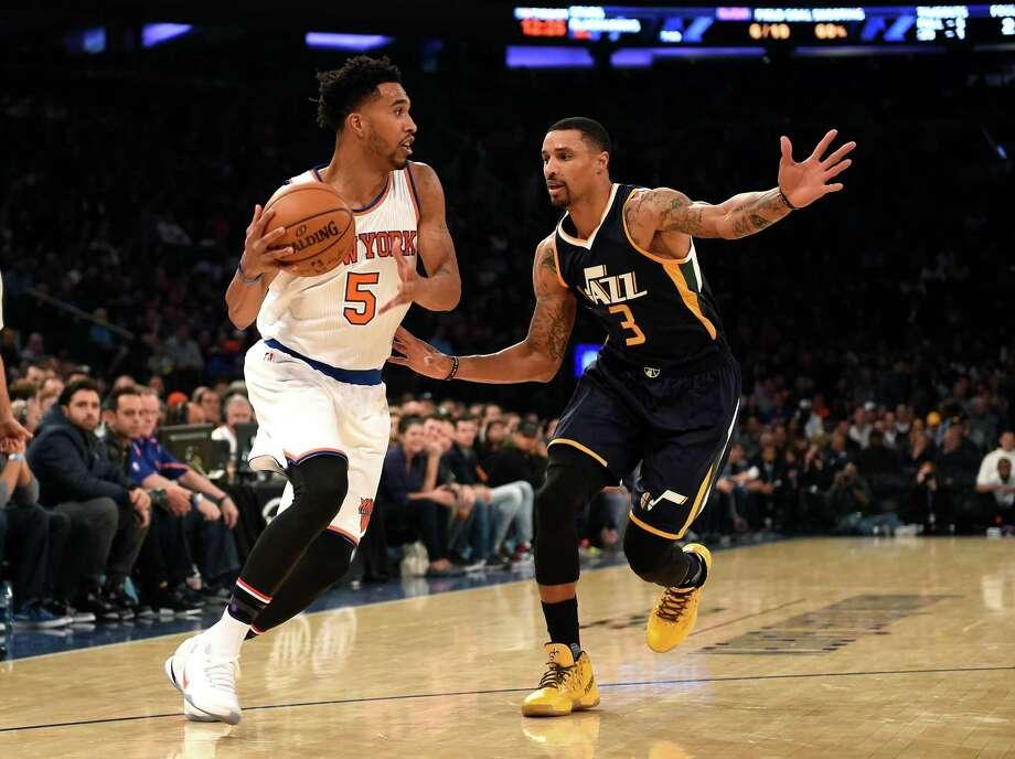 New York Knicks guard Courtney Lee (5) drives around Utah Jazz guard George Hill (3) in the first half of an NBA basketball game in New York, Sunday, Nov. 6, 2016. (AP Photo/Kathy Kmonicek) ORG XMIT: MSG104 Photo: Kathy Kmonicek / FR170189 AP