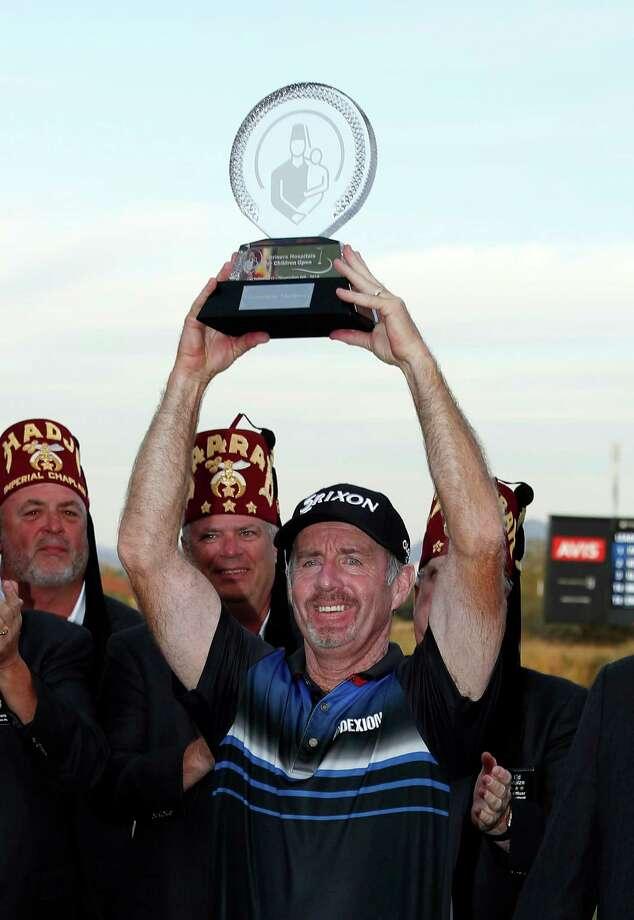 Rod Pampling, of Australia, hoists the trophy after winning the Shriners Hospitals for Children Open golf tournament Sunday, Nov. 6, 2016, in Las Vegas. (AP Photo/Isaac Brekken) ORG XMIT: NVIB112 Photo: Isaac Brekken / FR159466 AP