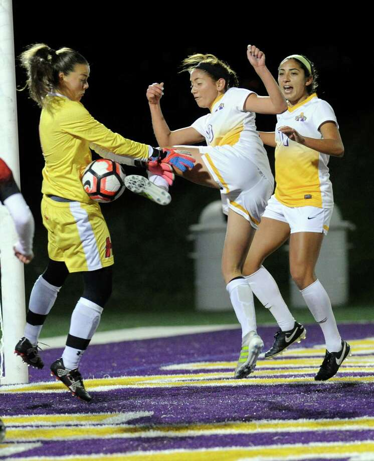 Hartford goalkeeper Jessica Jurg ,left, defends against UAlbany's Kiana Rugar ,center, and Vivian Vega, right, during an NCAA women's college soccer final in the America East Conference on Sunday, Nov. 6, 2016, in Albany, N.Y. UAlbany won the game 2-1.(Hans Pennink / Special to the Times Union) ORG XMIT: HP101 Photo: Hans Pennink / Hans Pennink