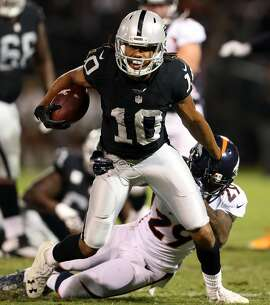 Oakland Raiders' Seth Roberts fights for yardage against Denver Broncos' Bradley Roby during 1st quarter of Raiders' 30-20 win in NFL game at Oakland Coliseum in Oakland, Calif., on Sunday, November 6, 2016.