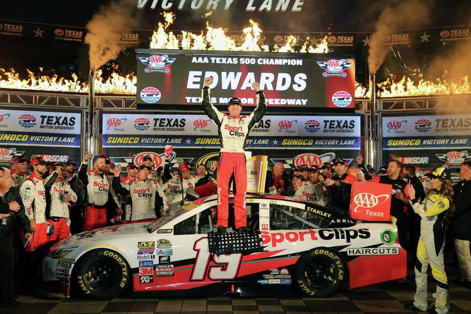 FORT WORTH, TX - NOVEMBER 06:  Carl Edwards, driver of the #19 Sport Clips Toyota, celebrates in Victory Lane after winning the rain-shortened NASCAR Sprint Cup Series AAA Texas 500 at Texas Motor Speedway on November 6, 2016 in Fort Worth, Texas.  (Photo by Jerry Markland/Getty Images) ORG XMIT: 680278023 Photo: Jerry Markland / 2016 Getty Images