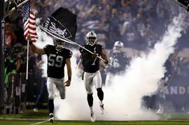 OAKLAND, CA - NOVEMBER 06:   Marquette King #7 of the Oakland Raiders leads the team on the field prior to the game against the Denver Broncos at Oakland-Alameda County Coliseum on November 6, 2016 in Oakland, California. (Photo by Ezra Shaw/Getty Images)