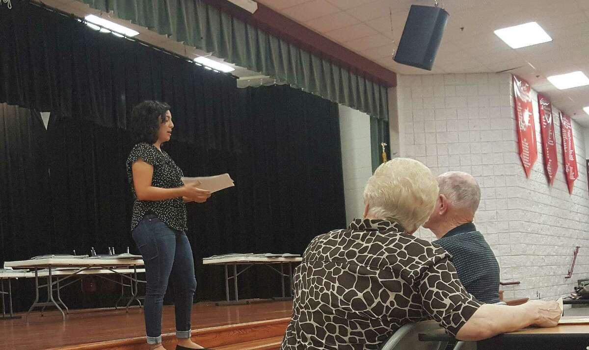 Priscilla Villa from Earthworks discusses the drilling operation near Lake Houston during a community meeting at Ben Bowen Early Childhood Center Thursday, Nov. 3.
