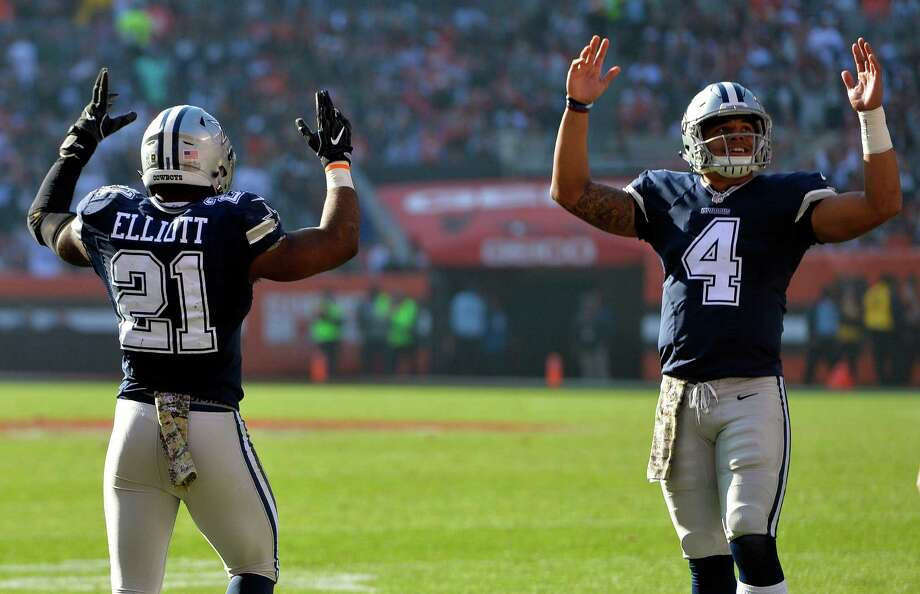 Dallas Cowboys running back Ezekiel Elliott (21) celebrates his touchdown with quarterback Dak Prescott (4) in the first half of an NFL football game against the Cleveland Browns, Sunday, Nov. 6, 2016, in Cleveland. (AP Photo/David Richard) Photo: David Richard, Associated Press / AP
