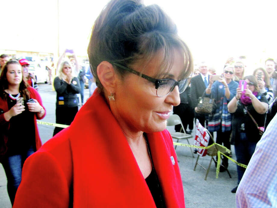 Former Republican vice presidential candidate Sarah Palin walks past a crowd as she arrives to speak on Sunday at the Republican Victory Center in Midland. Palin was in town campaigning for Donald Trump. / Midland Daily News