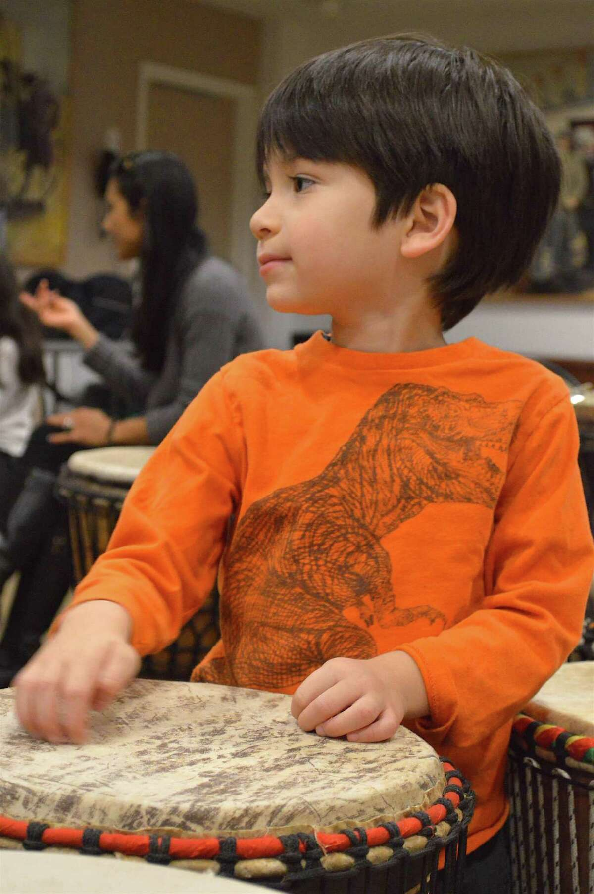 Elijah Green, 4, of Port Washington, N.Y., tests a drum at the Family Drum Circle held at New Canaan Library Saturday, Nov. 5, 2016, in New Canaan, Conn.