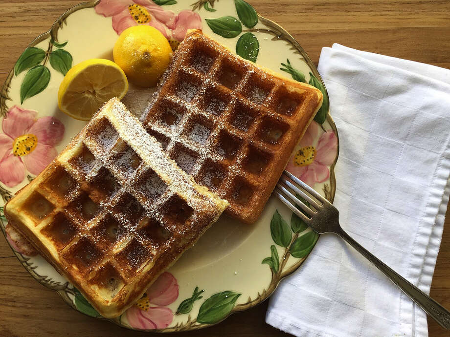 THE WAFFLING IS OVER ELECTION BREAKFAST: The French crepe treatment of powdered sugar and lemon lets the lush-but-light nature of the World's Best Waffles  shine through. Honey with squeezes of lime (which you'll find pancakes topped with in Thailand) is another sweet-and-tart way to go. (Bethany Jean Clement/The Seattle Times)