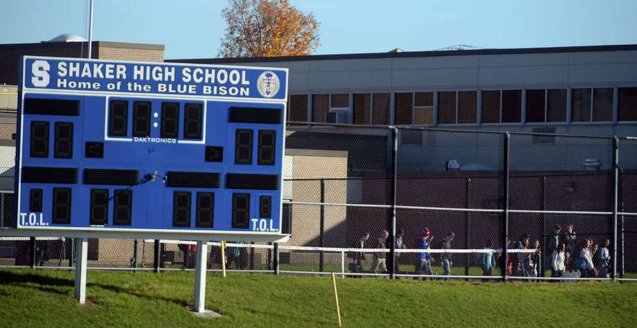 students make their way from the junior high school into shaker high school on monday morning