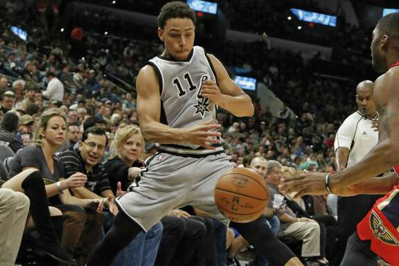 Bryn Forbes of the Spurs tries to save a ball from going out of bounds during against the New Orleans Pelicans at the AT&T Center on Oct. 29, 2016 in San Antonio.