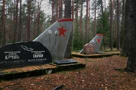 Soviet-era plane tails serve as grave markers just outside the entrance to Estonia's Amari Air Base, a reminder of the area's complicated history.