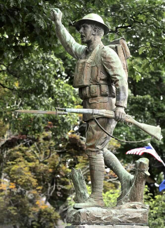 The doughboy statue in Bethel's P.T. Barnum Square park was removed in June to be refurbished. (File photo from July 2016) Photo: H John Voorhees III / Hearst Connecticut Media / The News-Times
