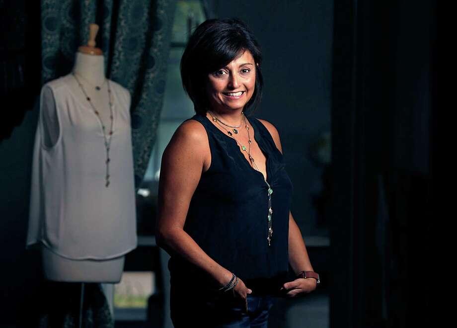 Jewelry designer Mirta Tummino poses for aportrait Nov. 1, 2016, in Houston. ( James Nielsen / Houston Chronicle ) Photo: James Nielsen, Staff / © 2016  Houston Chronicle