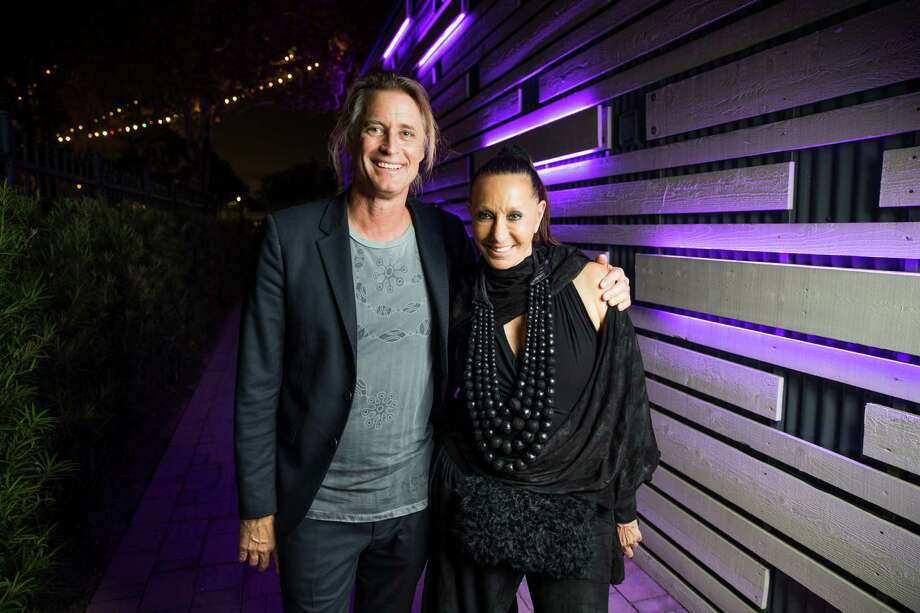 Photographer Russell James and designer Donna Karan at the Nomad Two Worlds Foundation reception Thursday, Nov. 3, 2016 in Houston. Photo: Michael Ciaglo, Houston Chronicle / © 2016  Houston Chronicle