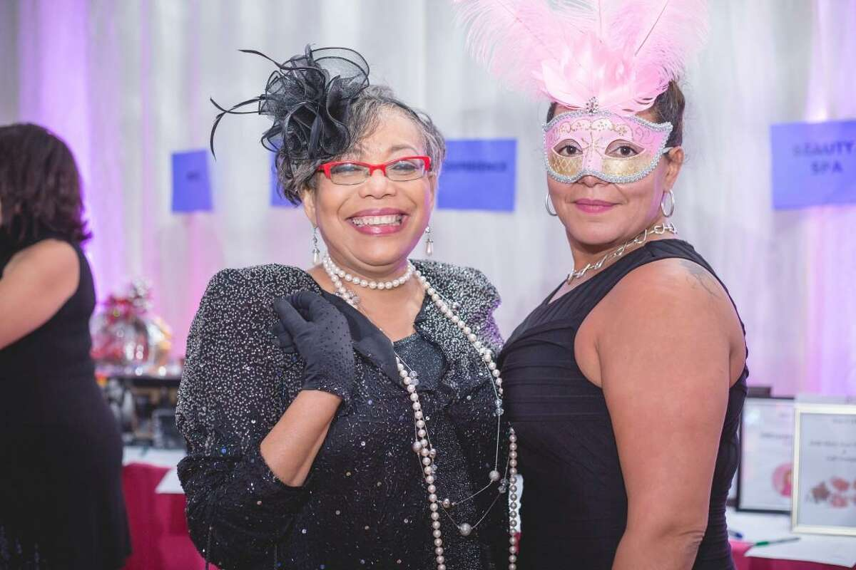 Bridgeport Neighborhood Trust's Beverly Hoppie, director of education and community engagement, and Elizabeth Torres, executive director, pose during the nonprofit's masquerade ball on Friday, Nov. 4, 2016. The organization announced during the event that it had won the Bank of America Neighborhood Builder award.