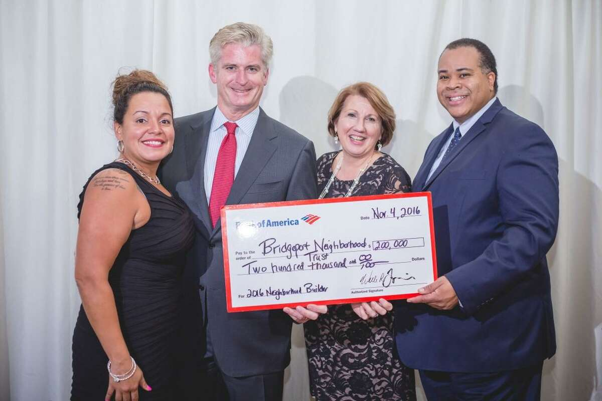 Elizabeth Torres, executive director of Bridgeport Neighborhood Trust, stands with, from left to right, Bill Tommins and Carol Heller from Bank of America and Terry Floyd, BNT's Board of Directors president. The bank recently presented the Neighborhood Builder award and a $200,000 grant to the nonprofit.