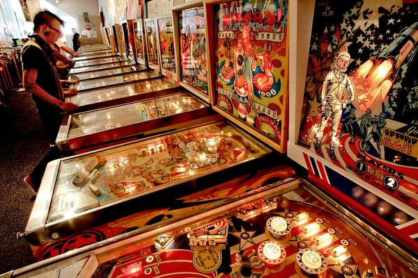 Players at the Pacific Pinball Museum in Alameda, Ca., on Friday September 14, 2012. The Pacific Pinball Museum is about to launch the sixth Pacific Pinball Expo.