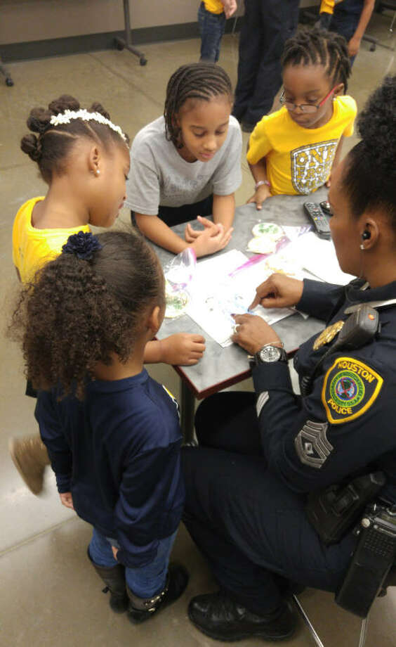Westbury Christian first-graders recently thanked officers at HPD's South Gessner Division for their service by delivering cookies the students baked and decorated. Photo: Westbury Christian