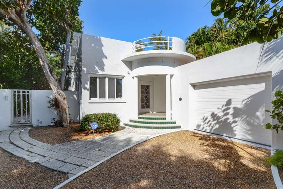 """The winner of the 1939 World's Fair's first-place prize as the """"Home of the Future"""" was  the Fore and Aft House designed by Belford  Shoumate. A real version of the model was built in Palm Beach, Florida, and is on the market for $7.995 million. toptenrealestatedeals.com Photo: Corcoran Group Real Estate"""