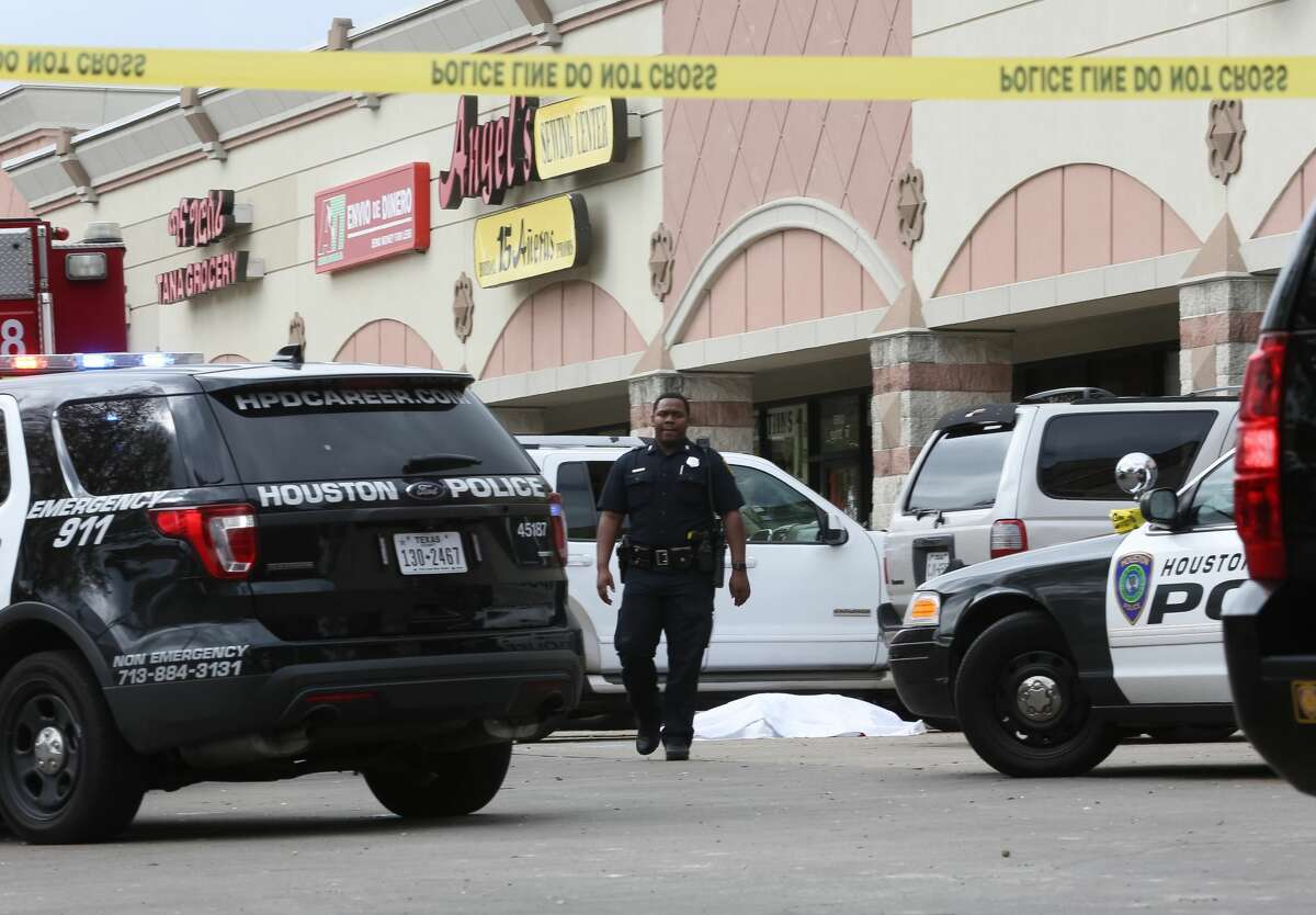 Authorities investigate a fatal shooting in the 5900 block of Chimney Rock, Monday, Nov. 7, 2016, in Houston.