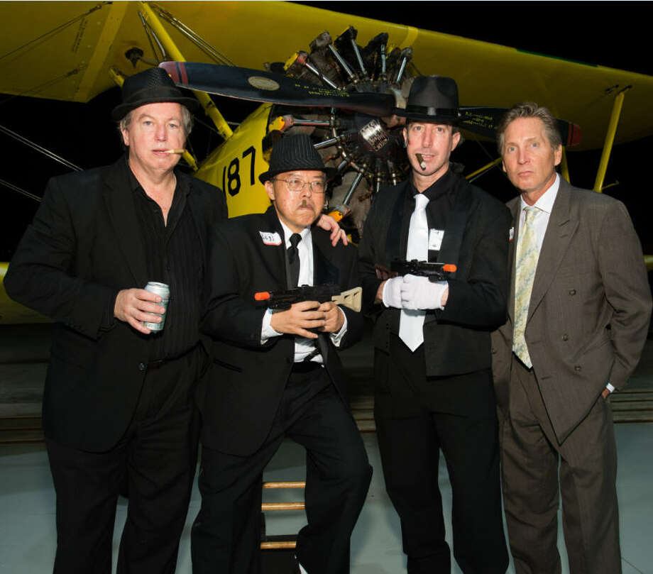 "A 1930''s Stearman Biplane served as one of the photo opportunities at last year's Speakeasy party. This year's Speakeasy will be Nov. 10. From left are:  Dennis """"Knuckles"""" Parmer, James """"Legs"""" Wong, Ira """"Mugsy"""" Liebman, and Steve """"Rocco"" Stewart. Photo: Randy Kozlovski"