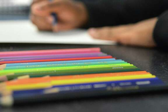 Students colored pencils to work on their journals during her Art 1 class on Monday November 7, 2016 at Brien McMahon High School in Norwalk Conn.