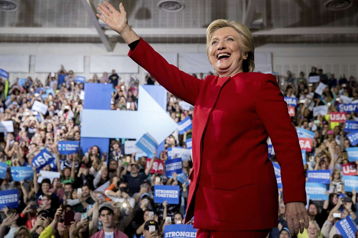 Democratic presidential candidate Hillary Clinton waves as she arrives to speak at a rally at Grand Valley State University Fieldhouse in Allendale, Mich., Monday, Nov. 7, 2016. (AP Photo/Andrew Harnik)