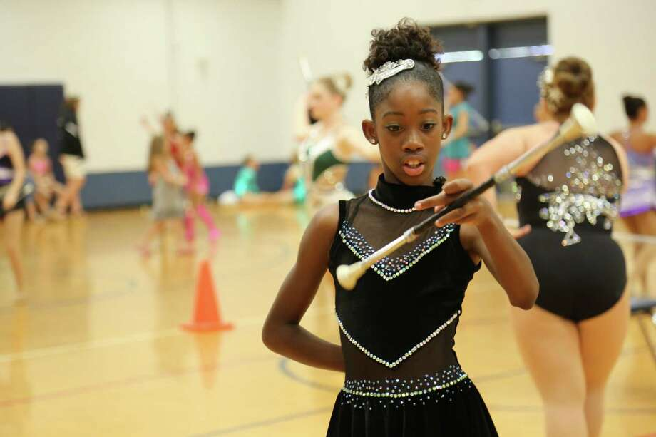 """Dazzling Divas twirling team captain Ivion, 11, is fearless in the spotlight. """"I'm too young to be afraid of failing,"""" she says.  Photo: TLC / Discovery Communications"""