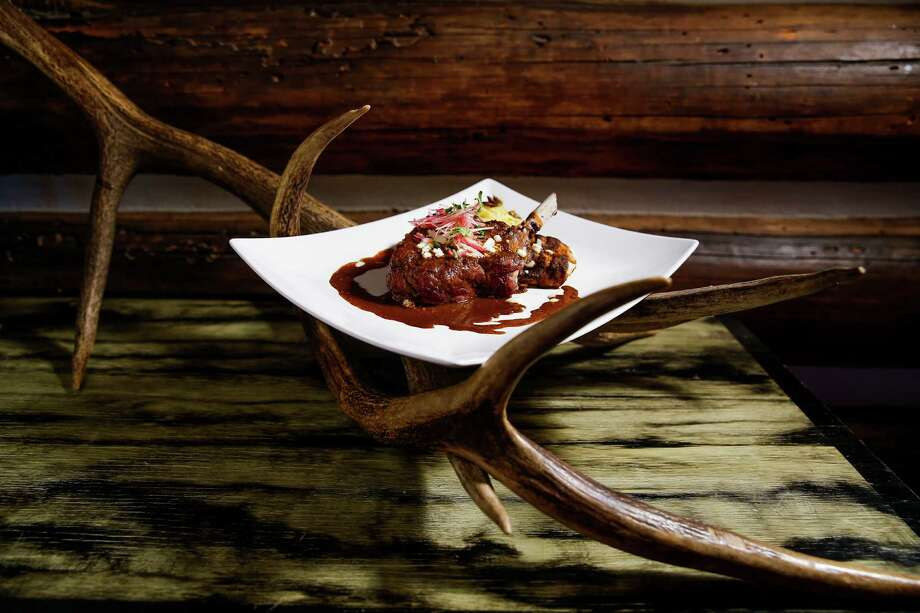 The elk chop, resiliently tender, boasts a flavor wilder and richer than beef. It's served with root-vegetable enchiladas and charred-tomato ancho mole - a regional twist on Houston's melting pot. Photo: Michael Ciaglo, Staff / © 2016  Houston Chronicle