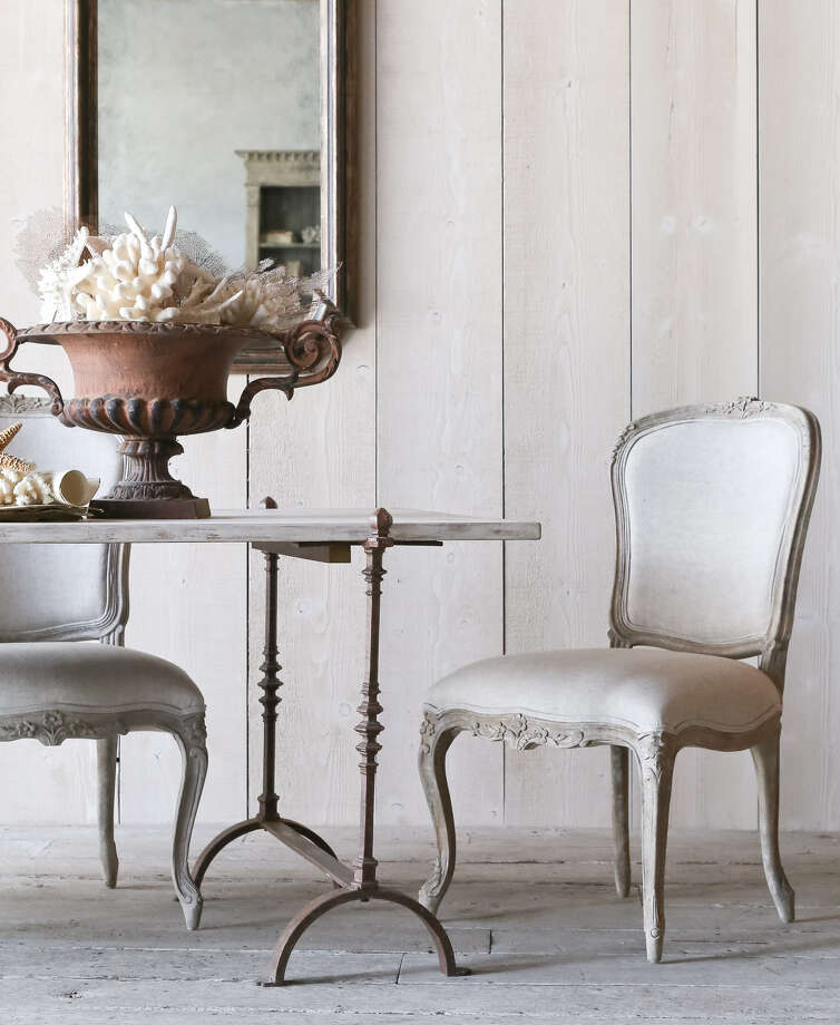 Modern furniture may be a huge trend, but antiques and their reproductions will always have a place in home design. This St. Remy Trestle Table from Eloquence Inc. is an antique reproduction featuring an Old World combination of metal and wood. Photo: Courtesy Photo