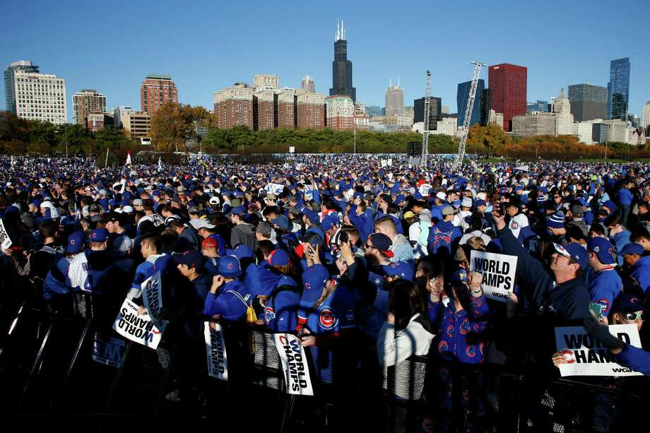 Chicago Cubs fans celebrate before a rally in Grant Park last Friday honoring the World Series baseball champions. Chicago's Office of Emergency Management and Communications estimated that 5 million people attended the event. Photo: Nam Y. Huh, STF / AP