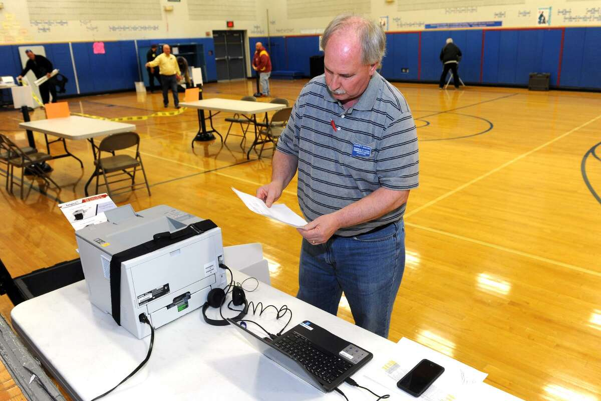 Registrar Rick Marcone tests a new voting station for handicapped voters as he and others prepare the gymnasium at Second Hill Lane Elementary School for Election Day voting in Stratford, Conn. Nov. 7, 2016.