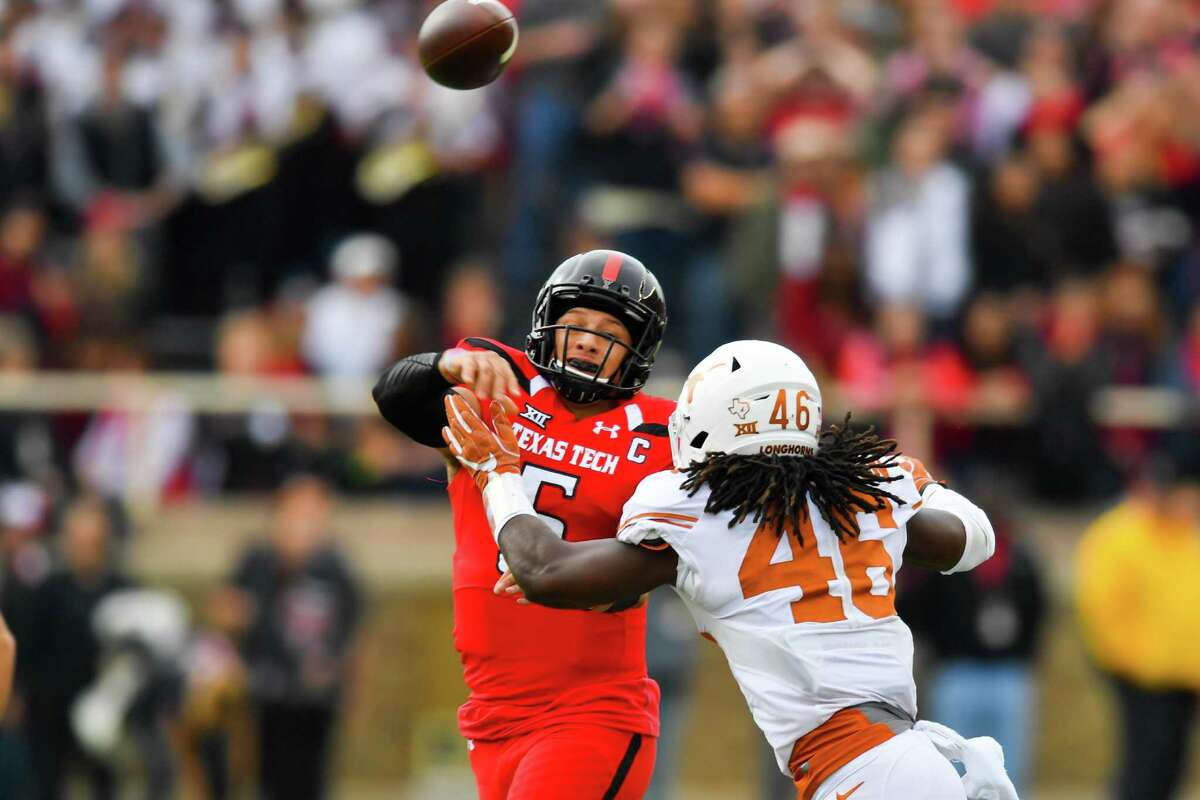 Patrick Mahomes II of the Texas Tech Red Raiders passes the ball while under pressure from Malik Jefferson of the Texas Longhorns during the first half on Nov. 5, 2016 at AT&T Jones Stadium in Lubbock.