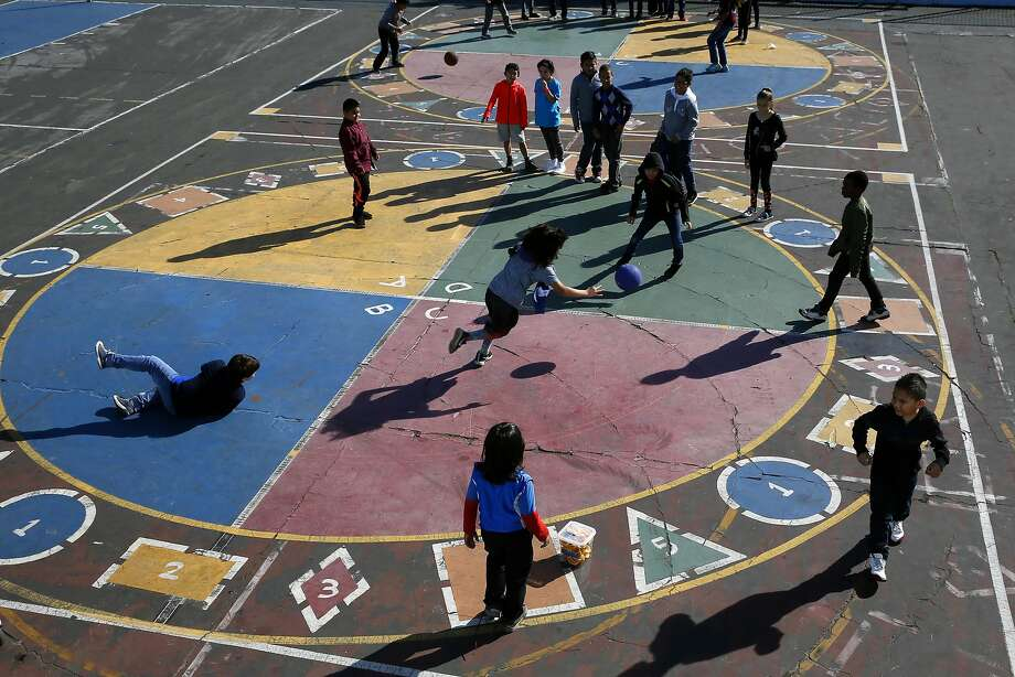 Students at San Francisco's Glen Park Elementary launch into a four-square game at recess. The school district's new report cards include ratings in some athletic skills, among many others. Photo: Michael Macor, The Chronicle