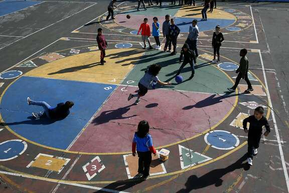 Students enjoys recess time and a game of four square at Glen Park Elementary School in San Francisco, California, on Thursday November 3, 2016