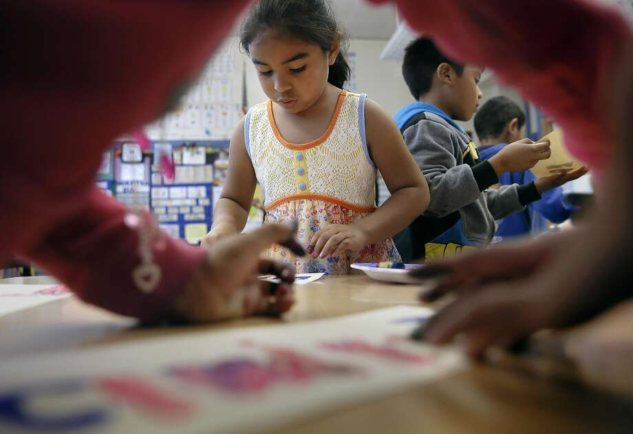 Maura Barrera works on an art project with classmates at Glen Park Elementary. New report cards assess art skills. Photo: Michael Macor, The Chronicle