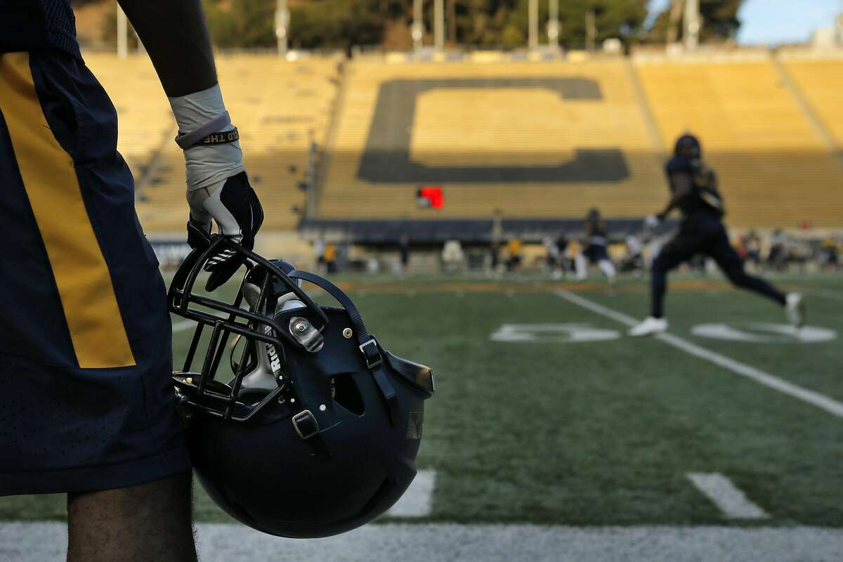 A player watches from the sidelines as the team goes through drills during football practice at Memorial Stadium in Berkeley, Calif., on Wednesday, November 5, 2014. Cal is making it much harder for student-athletes to be admitted to the University. Practice is at Memorial Stadium.