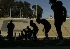 Players work on drills during football practice at Memorial Stadium in Berkeley, Calif., on Wednesday, November 5, 2014. Cal is making it much harder for student-athletes to be admitted to the University. Practice is at Memorial Stadium.
