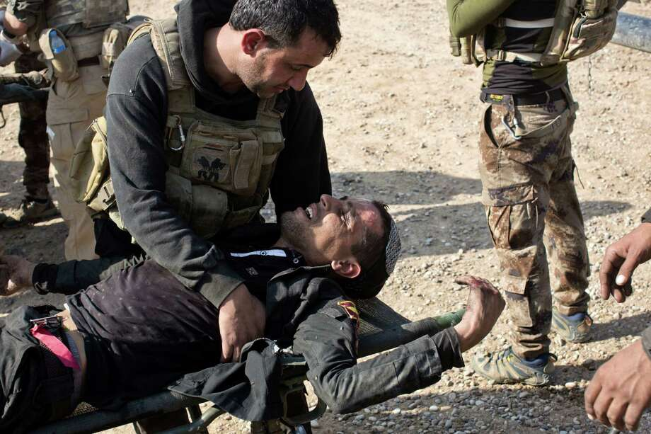 A wounded Iraqi special forces soldier gets treatment at a field clinic in Gogjali, on the eastern outskirts of Mosul, Iraq, on Sunday as Iraqi forces struggle to secure recent gains. Photo: Marko Drobnjakovic, STR / Copyright 2016 The Associated Press. All rights reserved.
