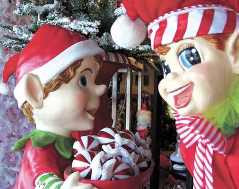 """Who's coming?"" ""Everyone!""  ""Yes!!!"" The elves and the humans at  Flowerland are excited to know you're stopping by to see their holiday  decorating ideas. It's all there for you at Flowerland, 413 Andrews  Highway in Midland. Photo: Paul Wiseman"