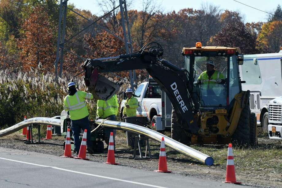 National Grid workers assemble sections of plastic gas pipe along North Greenbush Road on Monday, Nov. 7, 2016, in North Greenbush, N.Y.  National Grid is replacing 40-45 miles of older pipe in central and eastern New York. (Will Waldron/Times Union) Photo: Will Waldron / 20038713A