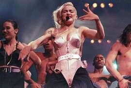 Pop singer Madonna performs during her Blond Ambition tour in Worcester, Mass., on June 4, 1990.  (AP Photo/Sandy Hill)