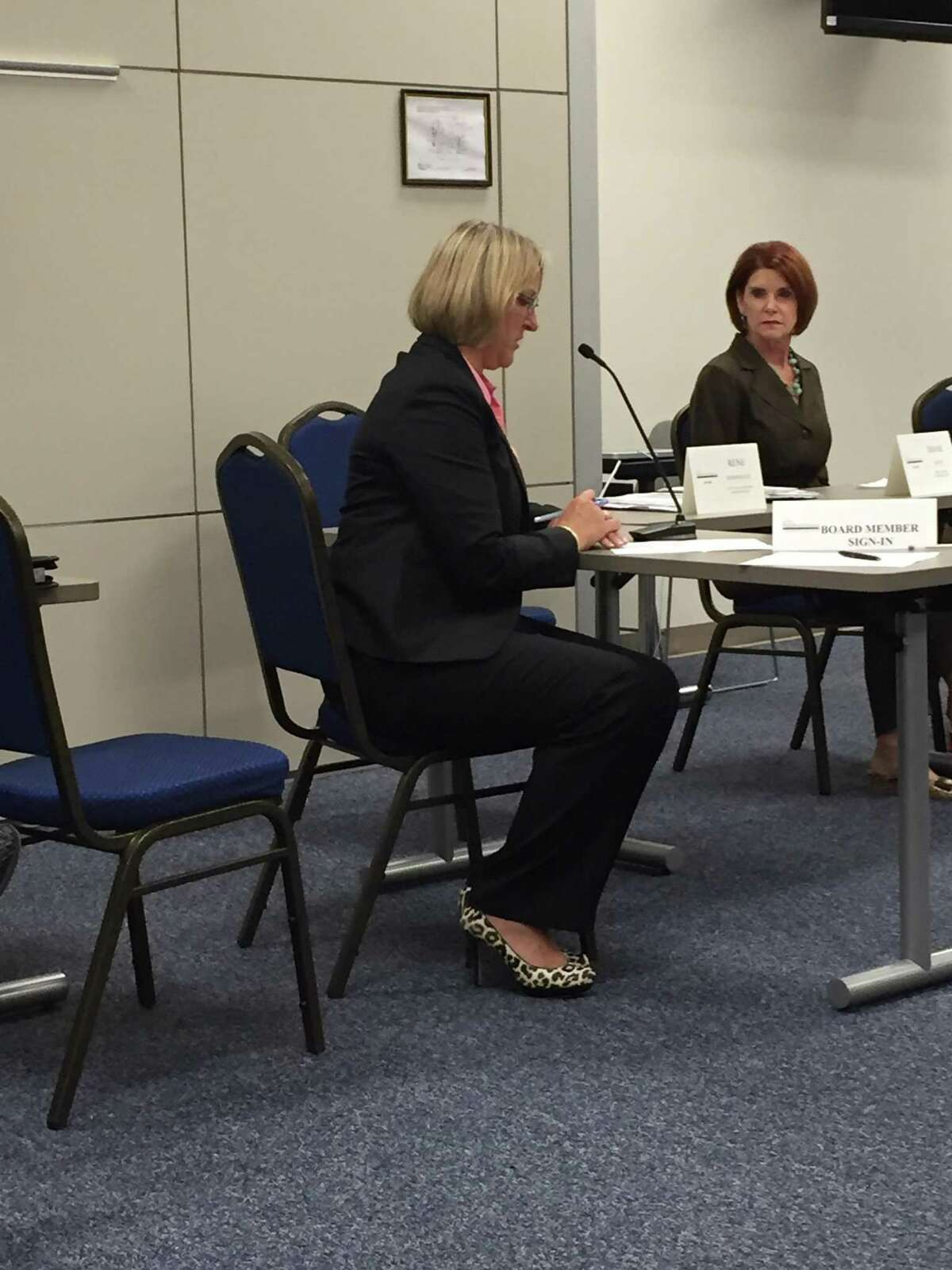 Gail Hathaway, left, speaks to the Workforce Solutions Alamo board at the start of a board meeting in November 2016. The board fired Hathaway, who then sued the organization for breach of contract. The suit was recently settled.