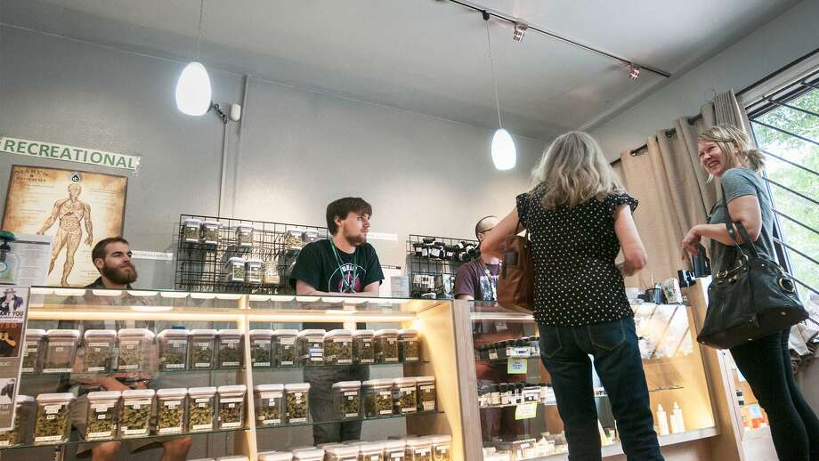 Many of the jobs created by legalized marijuana are lower-paying positions, like store clerks. Photo: Jeffrey Rotman/Getty Images