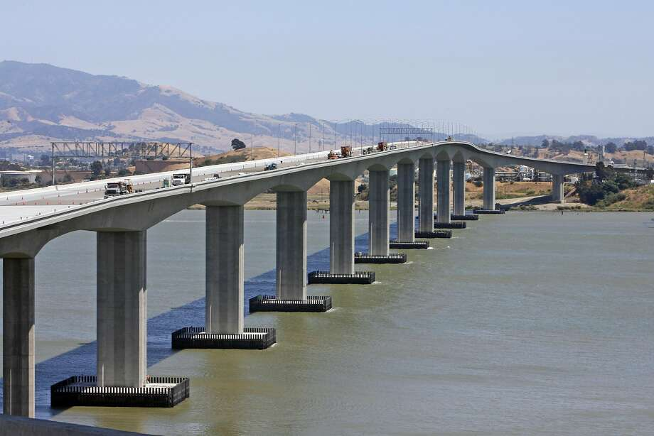 BRIDGE11_0128_cs.jpg  Event on 7/11/07 in Benicia.For The new Benicia-Martinez Bridge, looking south from the Benicia end is part of Interstate 680 and crosses the Carquinez Strait just west of Suisun Bay, linking Benicia with Martinez.  It is being constructed east of the railroad bridge, completed in 1930 and the original 1962 automobile span. It  will measure approximately 1.7 miles and carry five lanes of northbound traffic and is expected to be completed this year.   Photographed July 11, 2007. Chris Stewart / The Chronicle Ran on: 07-12-2007 The new Benicia-Martinez Bridge on I-680, seen from the north, is set to open in late August  --  seven years late. A small party is in the works. Ran on: 07-12-2007 Photo: Chris Stewart, SFC