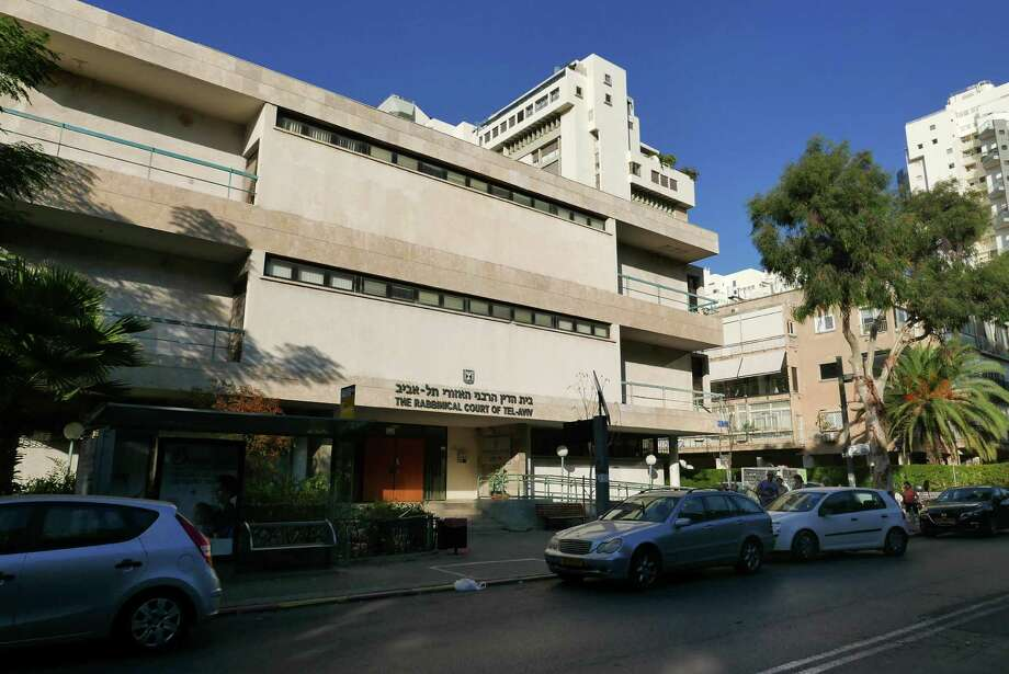 The headquarters of the chief rabbinate in Tel Aviv, Israel, Nov. 5, 2016. The rabbinate is a state-sanctioned institution that controls all matter of marriage and divorce in Israel. An American citizen has been holed up in a Jerusalem apartment for more than a year, unable to return to his home in the U.S. after an Israeli rabbinical court confiscated his passport and banned him from traveling, claiming he's the reason his son won't grant a divorce to his estranged wife for my than a decade. (AP Photo/Dan Perry) Photo: Dan Perry, STF / AP
