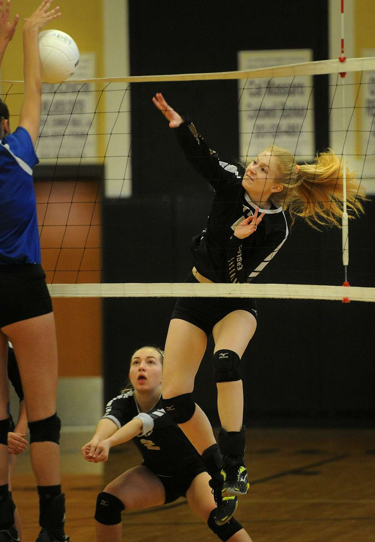 Trumbull's Liv Borski, right, spikes the ball off the block of Darien's Thea Bolton in the Eagles' 3-0 victory over the Blue Wave at Trumbull High School in Trumbull, Conn. on Monday, November 7, 2016.