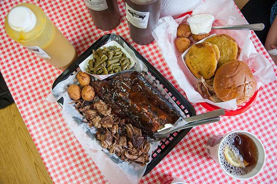 A barbecue sampler plate at Due South in Christiansburg, Va. The restaurant has five bottles of different - and delicious - barbecue sauces at the table. Photo: BRIAN NICHOLS, HO / BRIAN NICHOLS