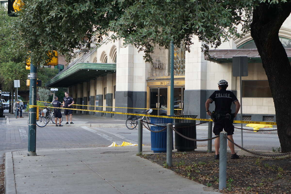 San Antonio police investigate the scene where a man fell from the top of the Tower Life Building in downtown on Monday, Nov. 7, 2016.